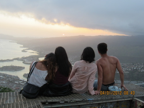 a little over a month ago my friends and I hiked up Koko head in Oahu. We were originally going to Hike Diamond Head but the park was closing and they wouldnt let us hike up. So my friend told me about Koko Head and warned me that it was really intense. He suggested we not do it…but of course we said fuck it. We still had one hour of sunlight left and it was our last night in Hawaii! So we hopped on our mopeds and rode 10 miles to Koko head. We got there and realized it was HELLA steep! But the sun was setting soon and we wanted to be at the top before it set. So we started up… 5 minutes later our thighs were burning, we were sweating like crazy, AND we didnt bring water. I felt like dying but I didnt want to give up. You only live once and I wanted to make it to the top even it killed me. So we kept at it. Then a bridge came up that required us to jump over holes; one slip and you would have went rolling down the mountain. Still, we pushed through and crawled across the bridge. Then it got steeper. and steeper. and steeper. fast forward 15 minutes and there we were…standing at the top. We ran over to get a picture just as the sun was setting. darkness fell as we started out descent…  Looking back at that hour we spent on that mountain really motivates me. Those moments really symbolize my life. Over the past four years I have been fucked over so many times. Ive moved 9 times, lived with 10 different roommates, and was even homeless at one point. But somehow, someway I was able to get passed it all. Now here I am getting ready to pack up and move again for the 10th time in college and I have no idea where I am going to go. The next two months is soooooo uncertain and I am scared shitless. I dont know where I will be living. I dont know where I will be working. I dont know anything. But what I do know is that I will succeed. My personality does NOT know failure. When I reach those obstacles I WILL keep on going. I WILL keep on pushing. Why? because I know it is going to be better once I get to the top.