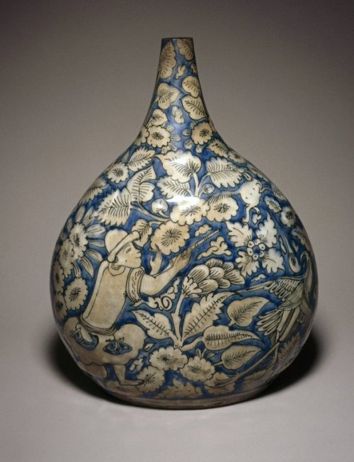 pppots:  Bottle Depicting a Hunting Scene Medium: Ceramic; fritware, painted in cobalt blue and black on an opaque white glaze Geographical Locations: Place made: Iran Possible place made: Mashhad, Iran  Dates: first half 17th century Dynasty: Safavid Period: Safavid Dimensions: 11 1/4 x 8 1/4 in. (28.5 x 21 cm)