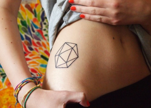 fuckyeahtattoos:  Icosahedron - one of the five Platonic Solids and symbol for the element of water. I'm a Cancer which means my element is water, and also I like geometric / symetrical shapes. Done by Tony at Tony Tattoo, Czech Republic.