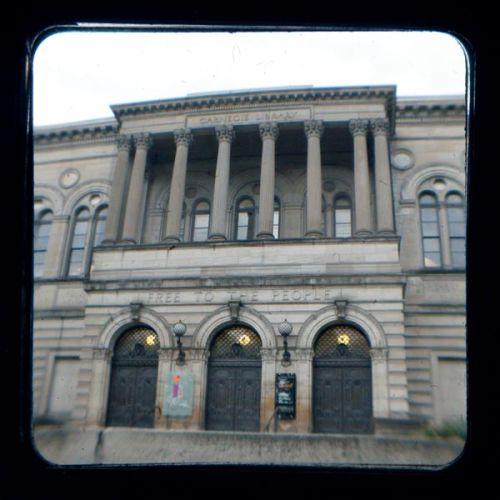 The Carnegie Library of Pittsburgh in Pittsburgh, Pa. This photograph is from the 2012 Pittsburgh Business Times Book of Lists. Photographer Joe Wojcik created the photograph using a modern digital single lens reflex camera to shoot through the viewfinder of a late 1950s Kodak Duaflex IV camera. This artistic process is called through-the-viewfinder (TTV) photography and it creates a vintage, retro feel that can simulate the look of older cameras. We'll be posting more of these images on Tumblr. You can find out more about the Pittsburgh Business Times Book of Lists at our website.