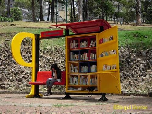 Colombia Brings Libraries to the Park Via Bilingual Librarian:  Monday morning I was out walking around downtown Bogota when I happened upon this lovely little library in the park. This stand makes part of the Paradero Para Libros Para Parques (PPP), a program created about 10 years ago to help promote literacy across the country. The program is part of Fundalectura in association with city parks. Currently there are 47 PPP in various neighborhoods of Bogota, and a total of 100 across the country. Each stand is staffed for about 12 hours a week by volunteer (they do receive a small stipend, but apparently it isn't much). The PPP are often open during the weekend and while in service they offer regular library services. Patrons can check books out, and the person staffing the PPP organizes activities (mainly for children), is available to answer questions, and often help children with their homework.