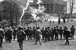 politicalprof:  At Kent State University, May 4, 1970. This was also the date of the only major Vietnam War confrontation at my university: in response to the shootings and deaths and Kent State, students at Illinois State went to the flag pole on the quad and lowered the flag to half mast. Workers building what is now the library and the student union left their work site and raised it back up—among other things, symbolizing the class divide regarding the Vietnam War, in which college students who were exempt from the draft protested the war, while working class people vulnerable to the draft supported it. America in a nutshell.