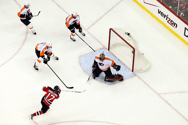 Ilya Kovalchuk scores a goal during the first period of Thursday's Flyers-Devils game. Kovalchuk, who has been fighting a back injury, scored three points in New Jersey's 4-3 overtime victory. The Devils have a 2-1 series lead. (Bruce Bennett/Getty Images) VIDEO: Watch highlights of Thursday's Devils-Flyers gameDATER: Kovalchuk key as Devils take 2-1 series lead