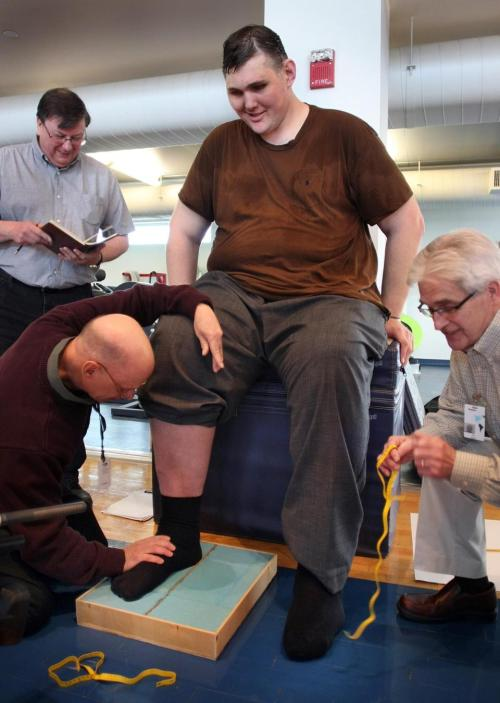"boston:  Reebok measures feet of tallest man in US for new shoes  - Igor Vovkovinskiy had started a social media campaign to get new shoes to help ease his pain, and Reebok offered to fit him for a free pair of shoes.  Coming up with a better pun than ""big shoes to fill"" for this story is going to be a tall order. (Sorry.)"