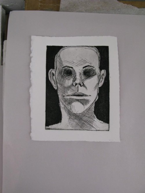 "The proof of an etching I am working on. It will be for an editioned book that may or may not be called ""The Book of Creepy Faces""  PS the photo was taken by Melissa."