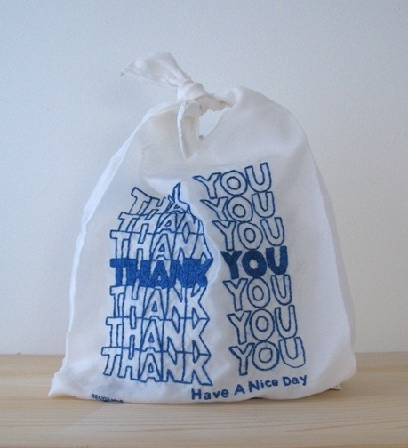 Thank You (x7 blue satin)2009Hand-embroidery on satin lining  It's a reusable bag that looks like a plastic bag, by Lauren DiCioccio. By way of this item, sent my way by Jennifer C. (thanks again!):  What good is a clunky reusable bag if you dont want to show it off? The THANK YOU THANK YOU tote bag is machine embroidered in red or blue on white taffeta. The bags are sturdy and washable totes, intended for daily use. The perfect THANK YOU gift, the totes replace the ubiquitous plastic bag with a friendly reminder to reuse and recycle. Made with care in The San Francisco Bay Area. Photos Kara Brodgesell