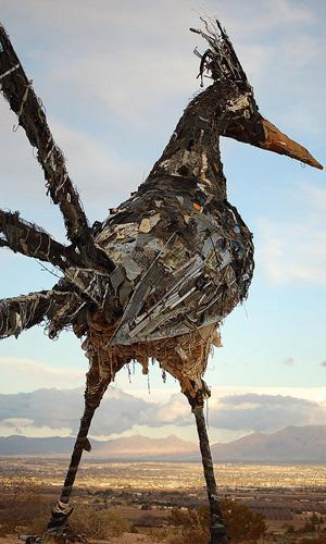 "mothernaturenetwork:  Recycled Roadrunner Standing atop a hill in Las Cruces, N.M., overlooking Interstate 10, is a 20-foot roadrunner sculpture made from trash from the city dump. The bird was built from a variety of objects, including toys, computer parts and sheet metal, but its belly was made almost entirely from discarded white shoes. Since the bird arrived on the mesa in 2000, people have been writing graffiti on the shoes. There are many declarations of love and generic ""I was here"" posts, but one blogger says this was his favorite message: ""I drive this truck so my boy can attend a good college and become something better than his old man ever dreamed. Look after me and my rig as I pass below, amigo."" 8 roadside attractions made from salvaged materials"