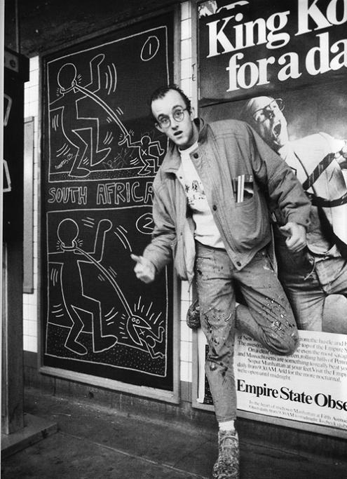 Keith Haring would be 54 today. As a fellow Pennsylvanian, I had the privilege of meeting his parents when I was 12yrs old to show them pictures our 6th grade class had drawn in the likeness of his art. I am proud to have gone to a public elementary school that in 1992 would have honored the memory of an artist who died of AIDS and wasn't afraid of bringing that into our impressionable young lives. I devoured everything thing I could about Haring from that moment on. His artwork is displayed on everything from t-shirts to coffee mugs. Some might disdain this mass production of his work but when I place the Keith Haring baby bib on the little girl I babysit, I can't help but smile knowing that even over 20yrs after his death, people like Keith Haring never truly die. Just by existing and sharing his art and life, Keith Haring served as a transformative figure. Happy Birthday to a beautiful artist and a beautiful person.