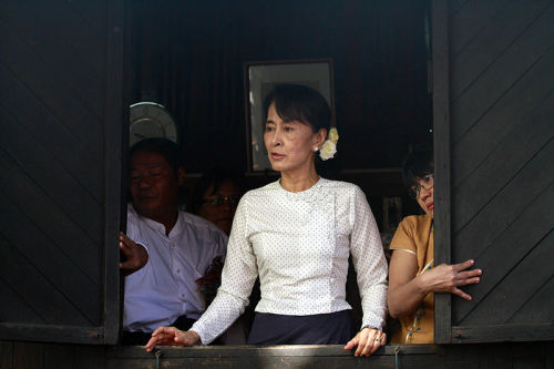 "The Democratic Voice of Burma | Suu Kyi embraces new role and compromise For over two decades pro-democracy leader Aung San Suu Kyi defied Burma's army rulers with steely resolve, but analysts say she has now embraced compromise, even if that means putting principles aside. The Nobel laureate was sworn in Wednesday as a member of parliament, a week after initially refusing to take the oath of office over the wording of the army-drafted constitution. She climbed down after President Thein Sein failed to offer concessions, indicating compromise may now be the order of the day as Burma creeps towards democracy in an astonishing reform process. But the delay meant that on Monday when UN chief Ban Ki-moon became the first foreign leader to make a speech at the nation's new parliament, Suu Kyi and her National League for Democracy colleagues were conspicuously absent. ""The NLD has given the impression, once again, of having missed the train,"" according to Renaud Egreteau, a Burmese expert at the University of Hong Kong. Many of Suu Kyi's supporters will welcome her historic debut in political office following the NLD's sweep in April's by-elections, held after an historic national vote in 2010. But Egreteau says there are indications of a divide within the NLD between hardliners reluctant to work with the military, and a more pragmatic group that Suu Kyi is increasingly inclined to join. FULL ARTICLE (AFP via The Democratic Voice of Burma)  Photo: Htoo Tay Zar/ Wikimedia Commons"