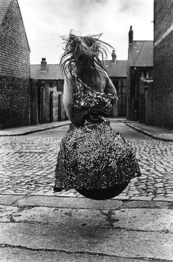 m3zzaluna:  girl on a spacehopper, byker, newcastle, england, 1971 photo by sirkka-liisa konttinen, from the photography book
