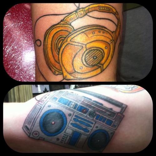 fuckyeahtattoos:  A star wars tattoo I did on my good friend Dizzy. C3p0 headphones and R2d2 ghetto blaster. May the 4th be with you.