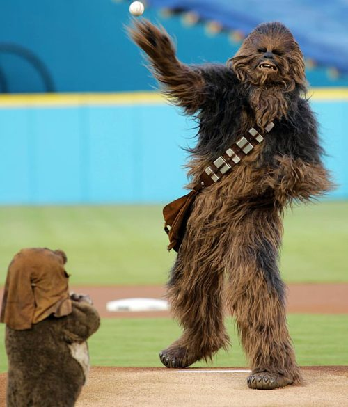 siphotos:  Friday is Star Wars Day across the nation. In celebration, here's a photo of Chewbacca throwing out the ceremonial first pitch to Wicket the Ewok before a Marlins-Nationals game. (AP)     GALLERY: Star Wars And Sports