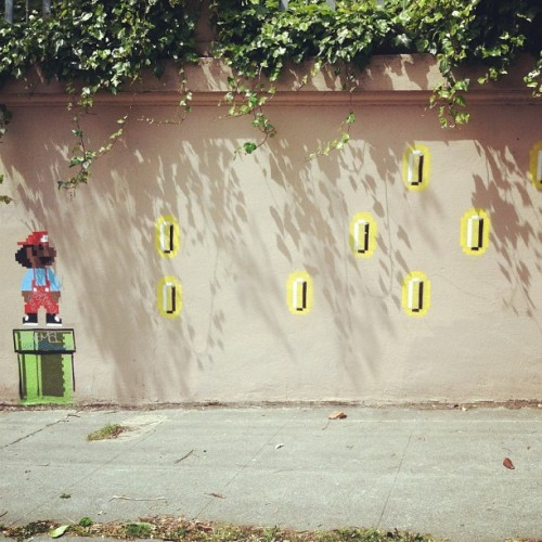 "it8bit:  Mario Street Art Photo by saucemeisterq  Quick, somebody jump all over the artist for ""blackwashing"" Super Mario. What do you mean that concept ""doesn't exist""?"
