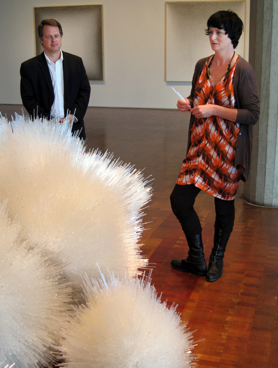 "Curator Brady Roberts and Tara Donovan, with Donovan's plastic-rod constructions. Photo Credit: Lee Ann Garrison for ThirdCoast Digest. Tara Donovan on the plastic-rod piece seen here, ""There are steel armatures inside. You need forklifts and chain hoists to move them. We had to figure how we could make them and how we could lift them. There was a lot of problem-solving involved.  I wouldn't say it's efficient to do these things. It takes an army and it takes time, because everything is hand-made. But the making is the reward."" Currents 35: Tara Donovan runs through Oct. 7 at the Milwaukee Art Museum."