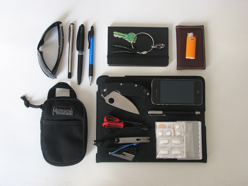 EDC By: publicutility iPad - Purchase on Amazon iPhone 4s - Purchase on Amazon Spyderco Tenacious - Purchase on Amazon Leather cardholder wallet - Purchase on Amazon Sunglasses  Moleskine pocket sketchbook - Purchase on Amazon Maxpedition Micro pocket organizer with… - Purchase on Amazon Primus fire starter - Purchase on Amazon Key Screwdrivers - Purchase on Amazon Micro Widgy Pocket Pry Bar - Purchase on Amazon Pocket straight razor(surgical prepared) - Purchase on Amazon Personal mini-first-aid kit - Purchase on Amazon some resistant tape (around an old card with a side-meter)  Bamboo Stylus for iPad & iPhone - Purchase on Amazon Parker pen - Purchase on Amazon Pentel sketching pen - Purchase on Amazon Faver-Castell mechanical pencil - Purchase on Amazon Orange Bic lighter