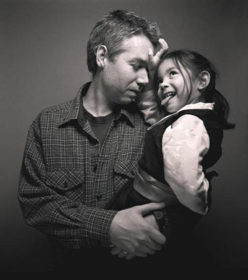 flexiblereality:  A beautiful photo of Adam Yauch and his daughter.   Rest in peace man. You'll always be a legend.