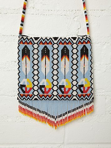"urbannativegirl:  ""Native"" beaded bag by Free People. #NativeAppropriations  it's moments like these where i seriously wonder if the people responsible for this even know what the medicine wheel is, or just thought ""oh i just really like the way white, yellow, red and black look together! and beads are just so pretty!""  free people is the fucking worst. their ad campaigns, their lookbooks, their products are always filled with rampant overpriced stereotypical items that are just a total mess. like this shit?! 162 dollars for a bag made by the ""*By Spell & the Gypsy Collective…"" wait, what? are you attempting to appropriate native american culture and then using a racist slur against romas to describe it?! for the record, free people is owned by the same people who run urban outfitters (and anthropologie) and they can all suck a bag of dicks for all i care. sidenote: if your only defense is ""but i like the way it looks!"" and you want to own something that looks like this? look up some ACTUAL native designers. support independent native artists and craftspeople. check out some of the many others people like lisa charleyboy (aka urban native girl) or jessica metcalfe (the great mind behind beyond buckskin). check out the beyond buckskin boutique. to me, this is the fashion equivalent of putting a bunch of native art in the ""craft/anthropology"" section of an art museum and putting the artist name ""anonymous."" do your research!"