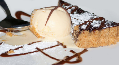 foodescapades:  Dark Chocolate Tart with Vanilla Ice Cream