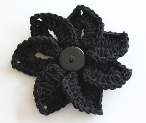 "bonitapatterns:  Here goes a free pattern for a Croco-Flower. It's quite easy… literally, just a couple of rounds that gives you an interesting 3-D effect. It can be worked in any yarn weight. However, heavier weight yarns like worsted or bulky weights works best to give it a sturdier texture. Even the good ol' Red Heart Super Saver works fine for this flower. Enjoy it!Designed by Lianka Azulay, Bonita PatternsCh 7, join with sl st in first ch to form a ring.Rnd 1: * ch 10, sl st in next ch, rep from * around, join with sl st in first ch – (7 ch-10 loops)Rnd 2: [sc, hdc, 8 dc, ch 2, 8 dc, hdc, sc] in first ch-10 sp * [sc, hdc, 8 dc, ch 2, 8 dc, hdc, sc] in next ch-10 sp, rep from * around, join with sl st in first sc. Fasten off. – (7 petals)Finishing: Attach a 1"" button sewn through the center of the flower.You may also sew Croco-Flower on a brooch setting so it is removable.© Bonita Patterns 2011  Embellish with flowers"