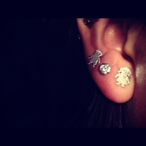 I have two cute lovers on my ear. If only in real life, could a guy give a girl a flower, and tell her he loves her, and mean it.