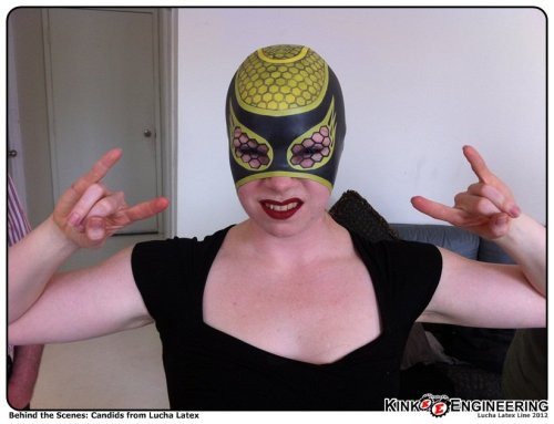 Axe: Behind the scenes at the lucha shoot. Trying on the Pollinatrix Hood.  Happy #Luchaday Everyone. More Latex Luchas in the Gallery - and in the store where we just launched our Lucha Latex Line. I'll keep posting stuff from our guest stars throughout the day, there's some interesting people out there!