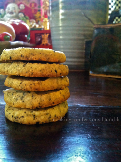 (Earl Grey) Shortbread Cookies (slightly adapted from foodnetwork) Ingredients:  2 cups flour 3 Tbsp Earl Grey Tea ½ Tsp Salt ¾ Cup Confections Sugar 1 Tsp Vanilla Extract 1 Cup Butter, room temp Directions:  In a food processor blend together flour, tea, salt and sugar until tea is evenly distributed.  Add vanilla and butter, blending until dough forms. Dough should be in either one or two large clumps, if not, blend longer.  Remove dough onto a sheet of plastic wrap and roll into a log. Depending on how big you want your cookies to be adjust diameter accordingly.  Wrap log in the plastic wrap, twisting or rubber banning the ends tightly, and refrigerate for 30-45 minutes.  Preheat over to 375 F. On a cookie sheet lined with parchment paper, cut the logs into slices about ⅓ of an inch thick. If you have left over dough wrap it back up and put back into the fridge to cool.  Bake cookies for 10-12 minutes, or just until bottom edges of the cookie are golden brown.  Remove from over and cool on a wire rack.  Enjoy! Cooks Notes:   — For the tea I used about 4 packs of bagged tea and the rest was loose leaf. This worked well because you were able to get the small pieces of the bagged throughout the cookie so the taste was there and the larger pieces of the loose leaf for that tiny bit of crunch.  — Next time I make these I will probably try it out with a different tea, maybe assam! This is a really good base for shortbread cookies, just leave out the tea or replace with something else.