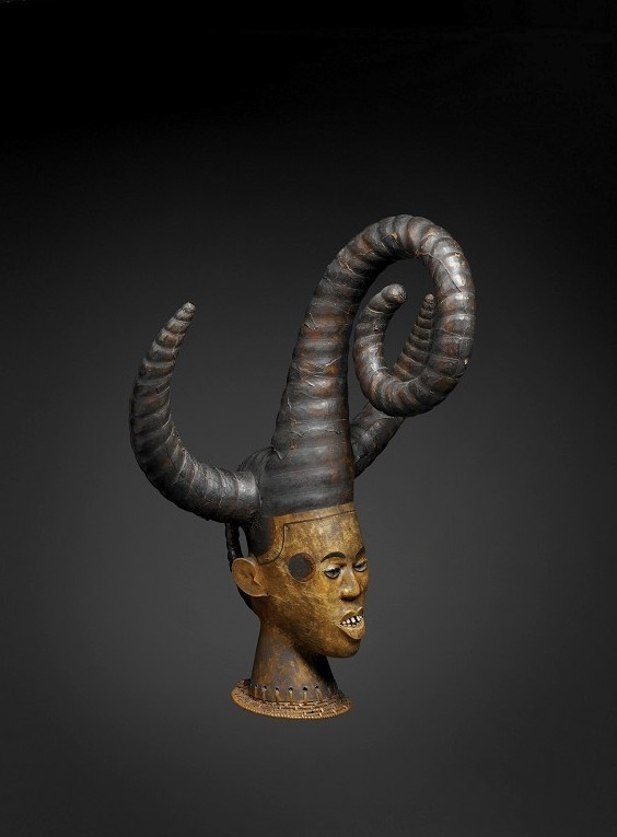 Ejagham mask, 20th century, Cross River, Nigeria. Wood, leather, metal and bones.  Mask used to perform warlike dances. Related to ancient customs of headhunting and cannibalism: the captured ennemy was eaten and his head was cleaned and dried to be used as the top of an helmet. Later the head was carved in wood and simply covered with human skin. - quaibranly.fr