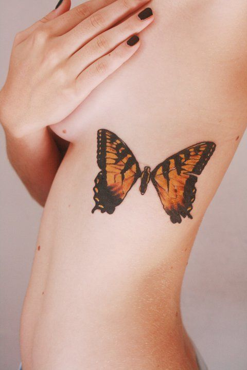 yelyahwilliams:  This is not me. But if I was ever gonna get a butterfly tattoo this is exactly what it would look like.  same. i was considering this once. but with the pins, like on the brand new eyes album.