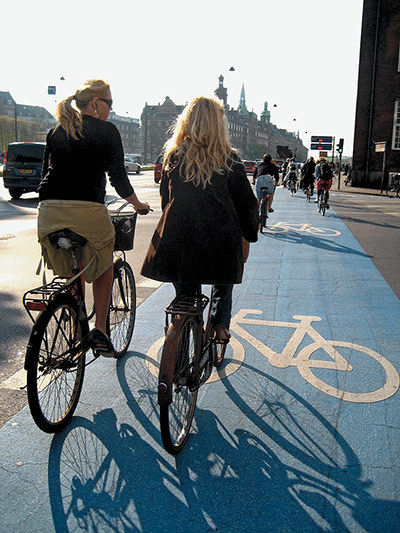 The Guardian - Big Picture:  Copenhagen bikes, by Mikael Colville-Anderson The guardian has published a great selection of Mikael Coville-Andersons pictures of people getting around their city (Copenhagen) on bikes.  Shows how cycling in the city can and should be - easy, convenient, safe, door to door, stylish…