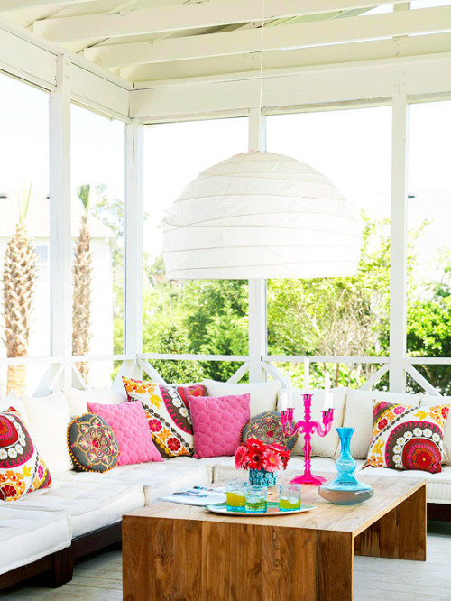 screen porch with white furniture and bald accents