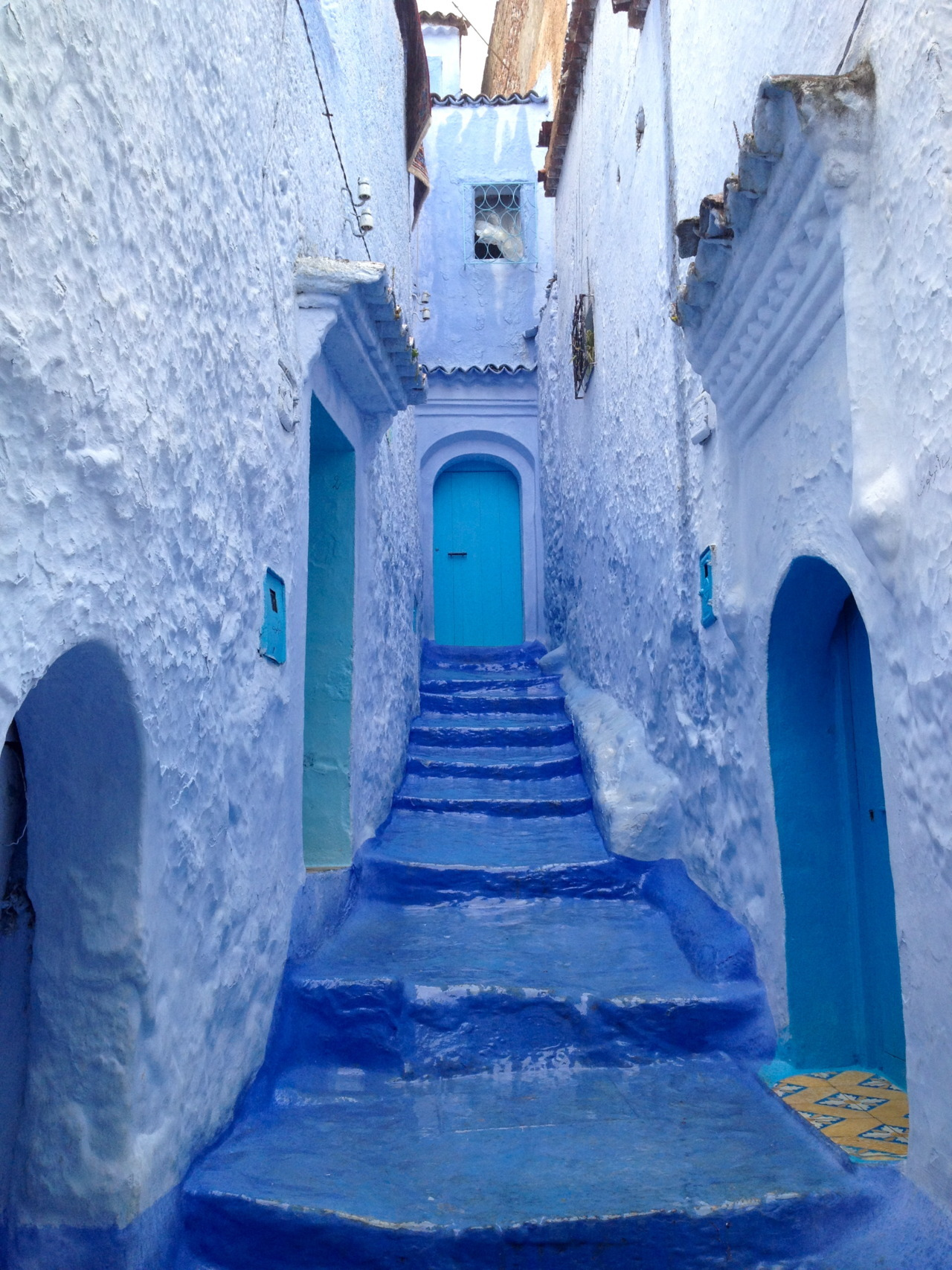 Morocco, Africa. They paint their town blue and white to keep it cool during the summer.