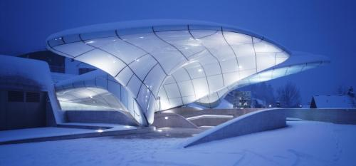 "Hungerburg railway by Zaha Hadid Architects in Innsbruck, Austria. I would like to use a quote from the original article here: (the railway) ""is like a trip through the mind of Zaha Hadid."" And really, the magical, icy, futuristic and amorphous railway with its stations as crowns really is an extraordinary addition to this capital of the Alps. As travel guides would state the structure is worth a visit itself."
