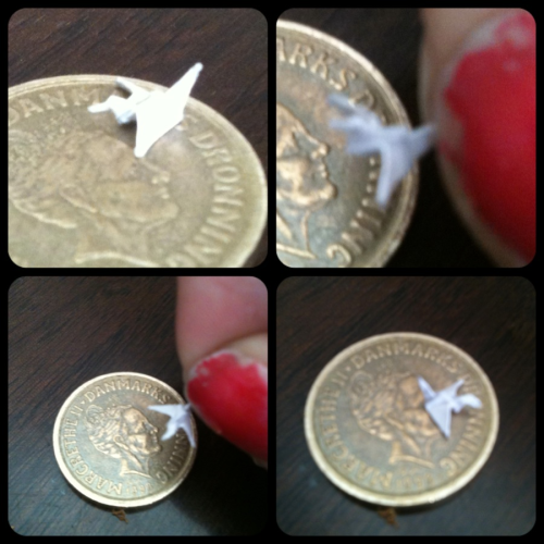 I think, that I just have made the smallest bird out of paper ever!!!! It's about 3-4 mm long (0.12-0.16 inches)