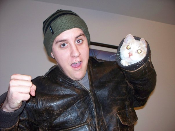 derpycats:   Seth the cat, featuring Jon.  Go go gadget, fist-cat.