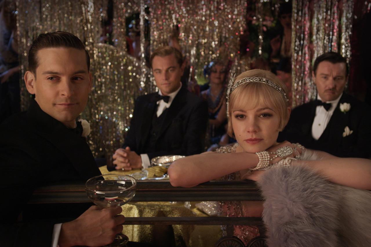 This is a still from the upcoming adaptation of The Great Gatsby. Tobey Maguire is Nick, Leo is Gatsby, Carey Mulligan is Daisy