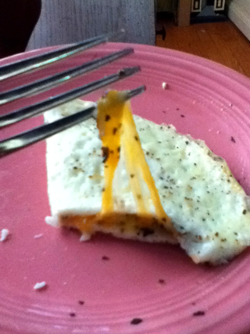Egg White Omelet with Cheese 100 kcal   3 Egg Whites(51 kcal) 1/8 Cup of Kraft 2% Colby and Monterrey Jack Shredded Cheese(49 kcal) Season to taste  Filling and Very Cheesy! Enjoy ^_^