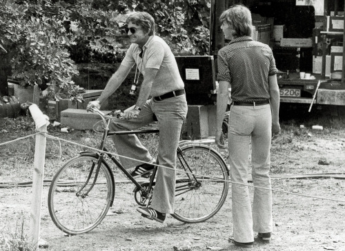 Blake Edwards rides a bike.