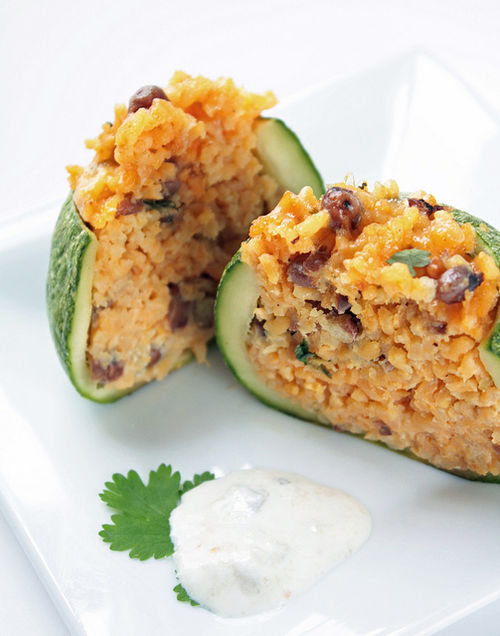 in-my-mouth:  Zucchinis Stuffed with Cheese, Rice and Beans