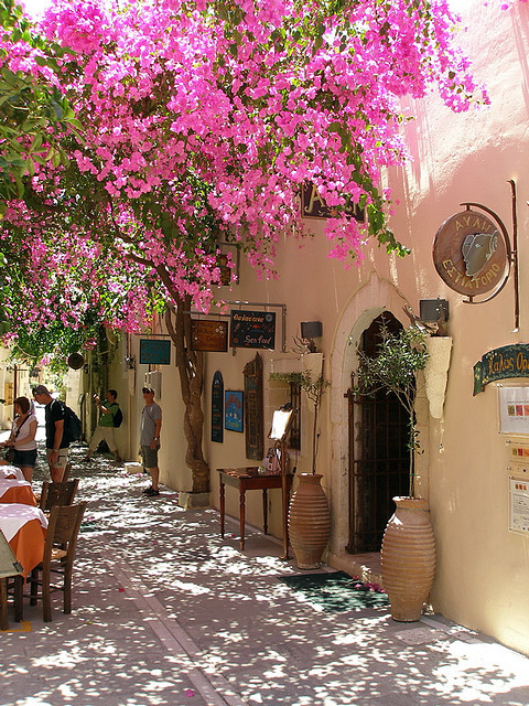 visitheworld:  Street scene with the bouganvillea vines in bloom, Rethymno, Greece (by tjensen99).