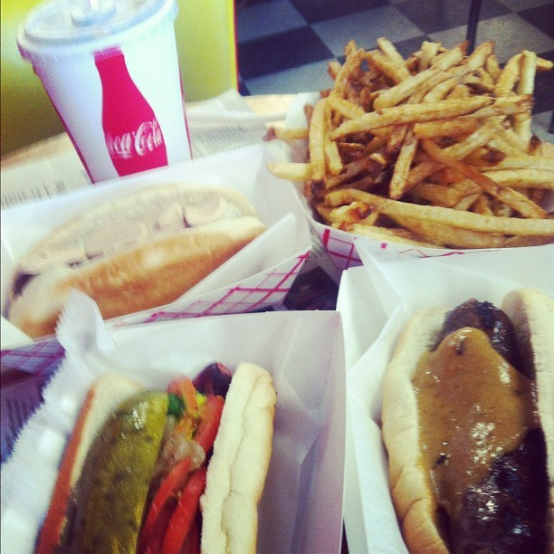 Foie Gras dog, venison dog with fig jam, a Chicago dog, duck fat fries, and a Coke.  (Taken with Instagram at Hot Doug's)