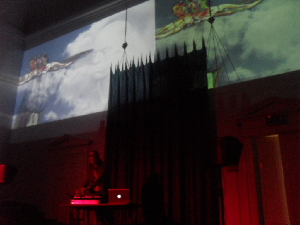 Last night I attended SoundScreen, an event run by Pop Up Brighton, who run arts events and exhibitions across Brighton with the aim of showcasing new talent. Presented in a beautiful Unitarian church, this was something quite special, as artists and musicians worked together in order to create a new, sensory experience that straddles popular culture and high end art. This is something to be really excited about, as the organisation themselves are quite keen to collaborate with other arts organisations in their share of resources, spaces and events. I'm currently writing a series of mini-essays that address this, and other issues, which I'm writing more for an exercise in my own curatorial ethics, setting my own standards as such. This was great though, people were so excited to talk about the future of the Brighton arts community, which seems to have become bigger and better in the last few months.