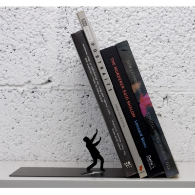 ahhhhh http://www.designmyworld.net/products-Falling-Books-Bookend_BE1.htm