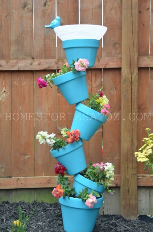 Wish I had a garden so I could make this topsy-turvy planter and bird bath.
