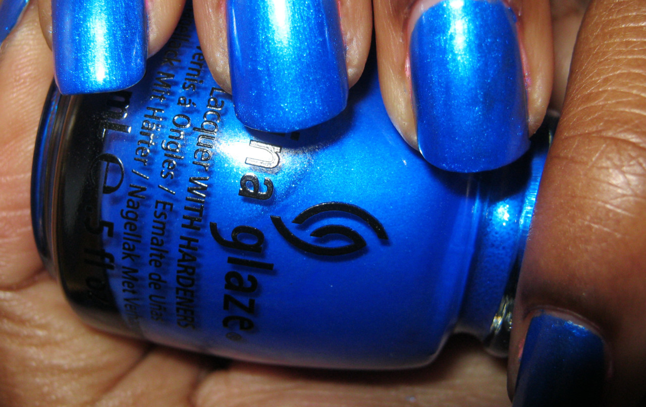 Frostbite (China Glaze)Price: $5.50MSRP: $7.50 This is a brilliant polish, and I mean brilliant because like Riveting it is lit from within. The shimmer is what runs this polish and it is eye-catching and light-catching. Application is a breeze, and it took three coats to get the pictures above so it's great coverage. It's a little wintery, as the name implies, but I wouldn't at all mind working it in the summer.