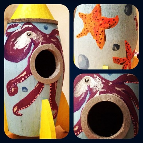 A #birdhouse that I painted with an #octopus and #starfish. And yes; it is in the #shape of a #rocketship :D  (Taken with instagram)