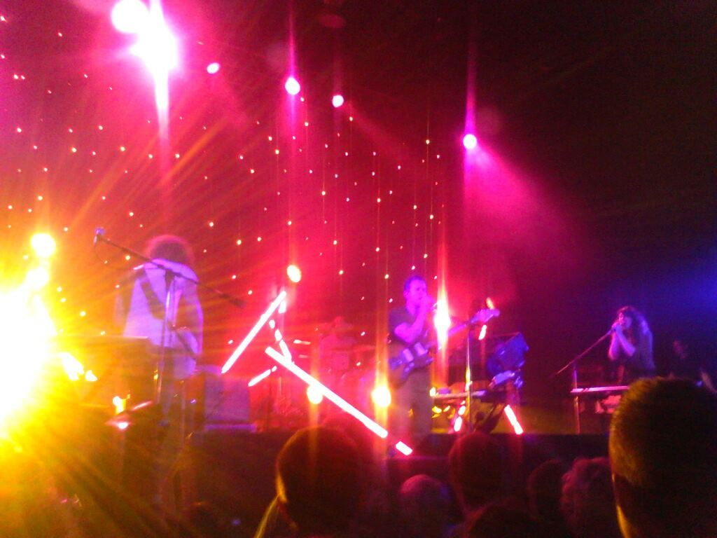 "I took this at M83's concert tonight. Even though I waited over an hour to get in and I paid a 200% markup on StubHub for the ticket (it was a sold-out show), this show was worth it.  So, so, so, so, so worth it. Anthony Gonzalez and his bandmates all play with an incredible passion. They seemed as enraptured by the music as the audience were. Their setlist was awesome. But what made this night so beautiful to me is that the last song they played was ""Couleurs"" which is my favourite. I lost my freaking mind, I swear. I was dancing with two random girls I met there from Chicago, and our hair and arms and hips were flying. Strobe lights danced on my face. I felt sweaty and happy and swept away and alive. For the first time in three weeks I felt alive.  It was so, so worth it."