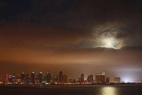 "ngtreblog:  sciencemeetsart:  Supermoon above San Diego on Flickr. Really it's just a full moon that's slightly bigger. Wanted to get a nice shot of the moon rising amongst the buildings in the skyline, alas a nice thick marine layer made that impossible until almost an hour after moonrise. But here you go, in all its super glory: the ""super"" moon and San Diego.  What an amazing night.  wtf! is this still going on tonight? :( I missed it :("