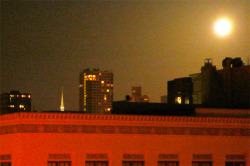 sfviewproperty:  Unbelievably gigantic Full Flower Moon rising over the cityscape dwarfing Grace Cathedral spire in the background.
