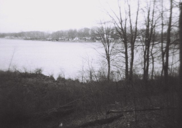 "Holga photo, Waterloo State Recreation Area in Michigan, early March 2012. The Holga is a ""toy"" cameras, made all out of plastic, even the lens. It's so cheap that it lets in weird light leaks. You can't really focus it or be sure of what exactly is in the frame when you're shooting. That element of surprise, especially because it's a film camera, is what makes it so appealing."