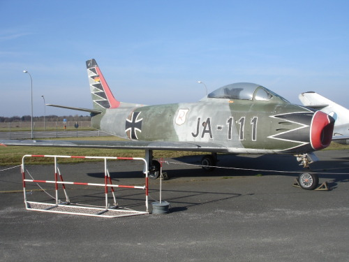 "remove-before-flight:  This Sabre on display in Berlin was part of JG-71 Richthofen, commanded by Erich Hartmann.  The ""black tulip"" design was on all the Geschwader aircraft, a copy of the one Hartmann used on ""Usch"" on the Russian Front."